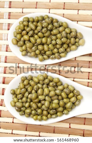 mung beans on white ceramic spoon