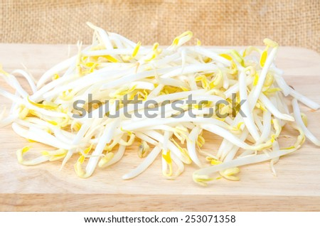 Mung beans or bean sprouts on wooden background.