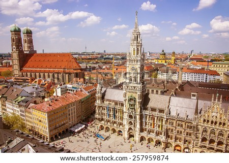 Munich city center skyline view to Marienplatz (main square) Frauenkirche and New City hall. It is a capital of Bavaria (Bayern) region in southern Germany.  - stock photo