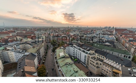 Munich City, Germany. Beautiful Panorama Aerial view of Munchen Old Town Skyline Cityscape sunset panoramic architecture under Dramatic Golden sky sunset at Dusk, Bavaria - stock photo