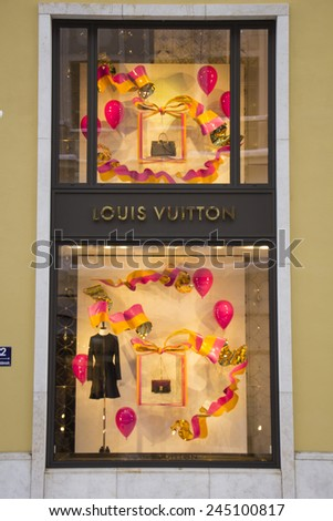 MUNICH - DEC 31: Shop windows are decorated at the Louis Vuitton store in Munich, Germany on December 31st, 2014.