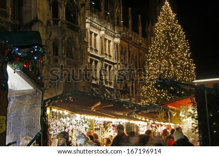 MUNICH - DEC 8: Tourist and locals visit the christmas market in front of the city hall at Marienplatz in Munich, Germany on December 8th 2013. - stock photo