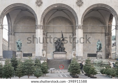 MUNICH - DECEMBER 4, 2015. Decorating pine tree for Christmas at Feldherrnhalle, Germany. ROME - DECEMBER 7, 2015. People sitting in restaurant and sightseeing around Piazza del Popolo in Rome, Italy. - stock photo