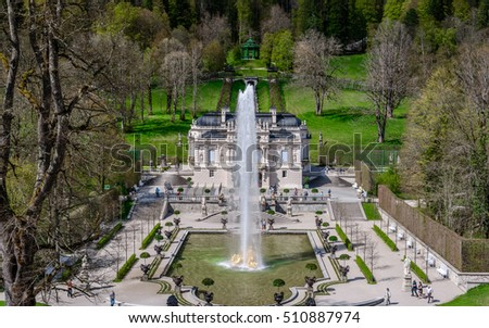 MUNICH (ETTAL, FUSSEN) GERMANY - 06 MAY 2016: Aerial panorama from the upper terrace on hill in the park near the Linderhof (the nineteenth century palace) with fountain, Germany - natural background