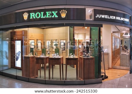 MUNICH, GERMANY - APRIL 1, 2014: Juwelier Hilscher Rolex watch store at Munich International Airport in Germany. Rolex was founded in 1909. It produces about 2,000 luxury watches daily. - stock photo