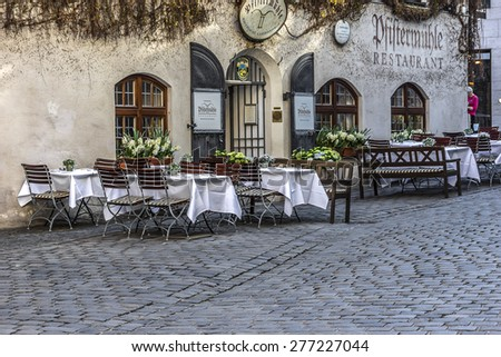 MUNICH, GERMANY - APRIL 21, 2015: Traditional Bavarian restaurant outdoor. Munich is the capital and largest city of the German state of Bavaria. - stock photo