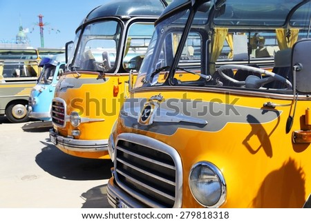 MUNICH, GERMANY - APRIL 19: yellow school buses presented at the annual spring old timer show on April 19, 2015 in Munich. Many old cars are presented on this show every year. - stock photo