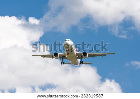 MUNICH, GERMANY - AUGUST 17: Airliner approaching the the airport in Munich, Germany on August 17, 2014. Munich airport has almost 40 million passengers a year.