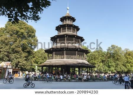 MUNICH - GERMANY- AUGUST 8, 2014 Beergarden at Chinese Tower, English Garden, Munich, Upper Bavaria, Germany - stock photo