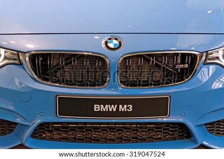 MUNICH, GERMANY - 4 AUGUST 2015: BMW M3 shown at BMW World showroom in Munich, Germany. - stock photo