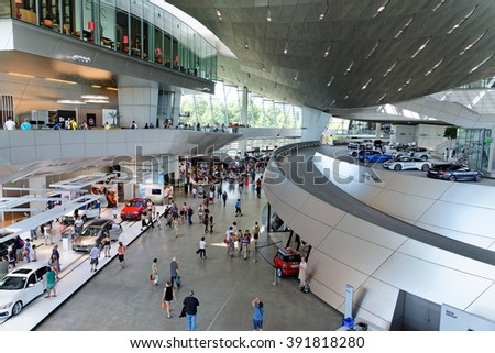 MUNICH, GERMANY - 4 AUGUST, 2015: Interior Space of BMW Welt, a multi-functional customer experience and exhibition facility of the BMW. It is designed by COOP HIMMELB(L)AU. - stock photo