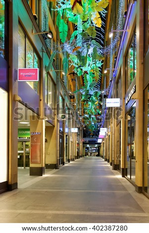 MUNICH, GERMANY - AUGUST 2, 2015: Kaufingertor shopping passage with arcade-shaped glass roofing. There once stood a town gate at the time of the first town wall over 800 years ago. - stock photo