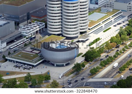 MUNICH, GERMANY - AUGUST 4, 2015:MUNICH, GERMANY - AUGUST 4, 2015: Aerial view of Munich with the BMW Museum and headquarters from the 291 m high Olympic tower (Olympiaturm). - stock photo