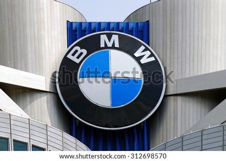 MUNICH, GERMANY - 4 AUGUST 2015: Opened in 1973, the BMW four cylinder tower (BMW Hochhaus Vierzylinder) is the world headquarters of German auto maker BMW. - stock photo