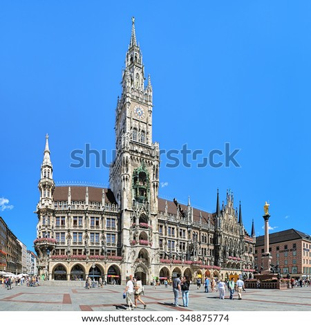 MUNICH, GERMANY - AUGUST 26, 2010: Panoramic view of Marienplatz with New City Hall and Mary's Column. The New City Hall was built in 1867-1908 by Georg von Hauberrisser in a Gothic Revival style. - stock photo