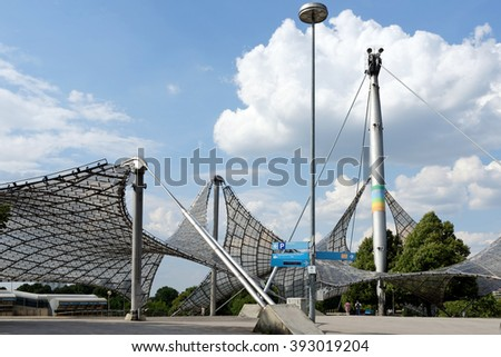 "MUNICH, GERMANY - 4 AUGUST 2015: Part of ""Olympiahalle"" unique rooftop, constructed for the purpose of the 1972 Summer Olympics in Munich, Germany. - stock photo"