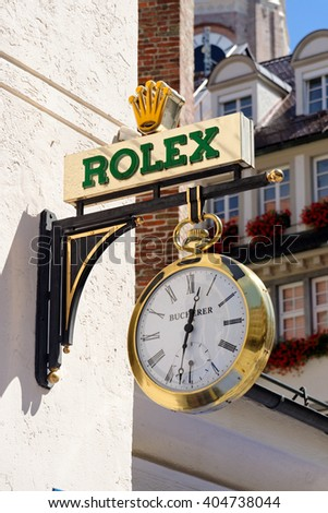 MUNICH, GERMANY - AUGUST 3, 2015: The logo of the brand Rolex. It was founded in London, UK, in 1905 and moved its base of operations to Geneva, Switzerland in 1919. - stock photo