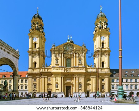 MUNICH, GERMANY - AUGUST 26, 2010: Theatine Church of St. Cajetan (Theatinerkirche). The church was built in 1663-1690 in Italian high-Baroque style with facade in Rococo style completed in 1768. - stock photo