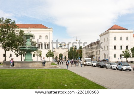 MUNICH, GERMANY - AUGUST 25: Tourists at the Ludwig Maximilian University of Munich, Germany on August 25, 2014. The university is among  the oldest universities of Germany. - stock photo