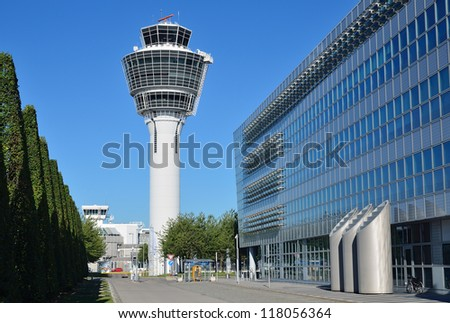 MUNICH, GERMANY - AUGUST 12: View of airport buildings on August 12, 2012 in Munich, Germany. Airport Franz-Josef Strauss is the second largest in Germany. Pass every year about 30 million passengers. - stock photo