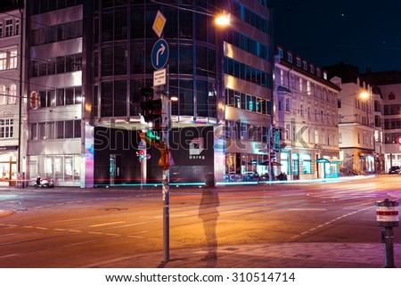 MUNICH, GERMANY - CIRCA APRIL 2015: Ghost sillhouette of a woman in night streets of Glockenbach gay district in Germany, Munich - stock photo