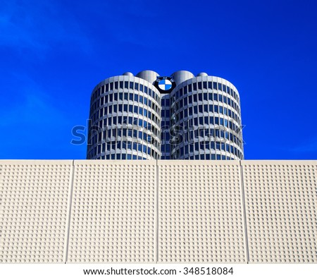 "MUNICH, GERMANY - DECEMBER 5, 2015: BMW Headquarters in Munich, the office  tower aka ""Vierzylinder"" - stock photo"