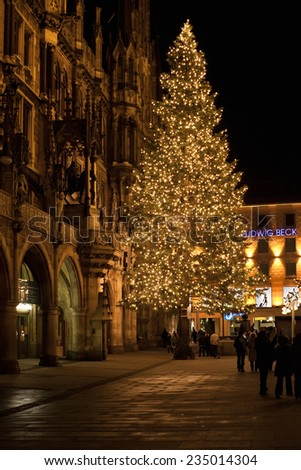 MUNICH, GERMANY - DECEMBER 25, 2009: Christmas tree at night with lights. Marienplatz square in Munich, Germany. Marienplatz is a central square in the city centre of Munich, Germany.  - stock photo