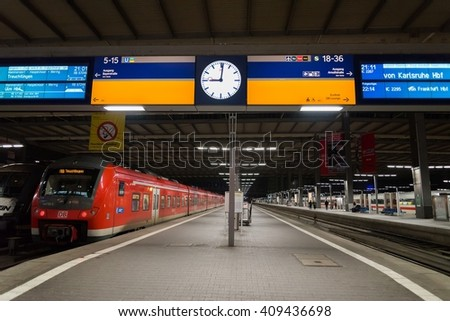 MUNICH, GERMANY - FEBRUARY 18, 2016: A commuter train waits at the Munich Main Railway Station (Munchen Hauptbahnhof). The train is part of Deutsche Bahn's fleet, the German national railway company. - stock photo