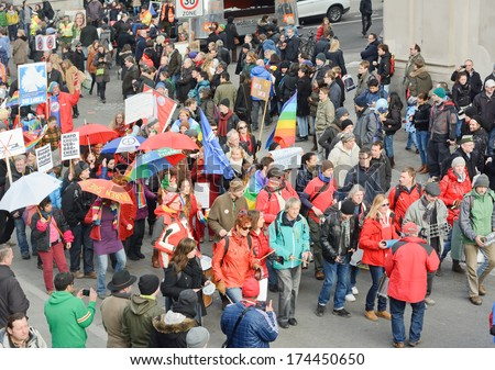 MUNICH, GERMANY - FEBRUARY 1, 2014:  Protesters at the Munich Security Conference during their annual meeting.  - stock photo