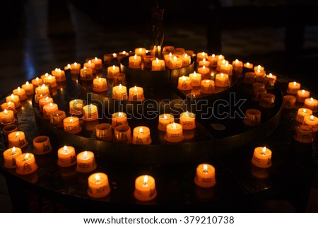Munich, Germany - January 02 2016: Candles for prayers in Saint Peter Church, situated on the Rindermarkt street