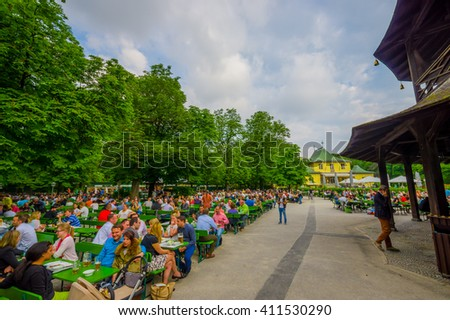 Munich, Germany - July 30, 2015: Famous local Chinesischer Turmgarden, full of people enjoying drinking beer on a beautiful summer day