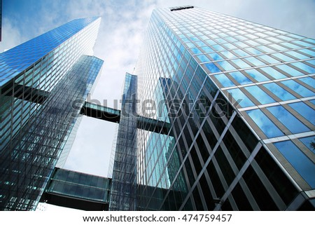 "MUNICH, GERMANY - JULY 31: modern skyscraper ""Twin tower"" in Munich on July 31, 2016. Offices of different companies and hitel are located in this building."