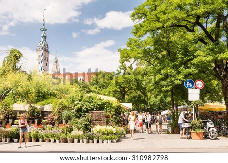MUNICH, GERMANY - JULY 20: People at the Viktualienmarkt in Munich,  Germamy on July 20, 2015. This traditional market takes place every day since 1807 .  - stock photo