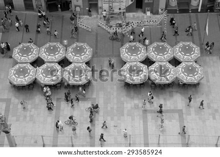 MUNICH, GERMANY - JUNE 3, 2015: Beautiful Weather Brings out Shoppers and Diners in Front of the City Hall on the Marienplatz in Munich, Germany. - stock photo