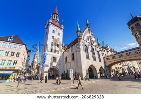 MUNICH, GERMANY - 19 JUNE 2014: The old town hall architecture in Munich, Germany. The Old Town Hall bounds the central square Marienplatz on its east side, was constructed in 1392/1394. - stock photo