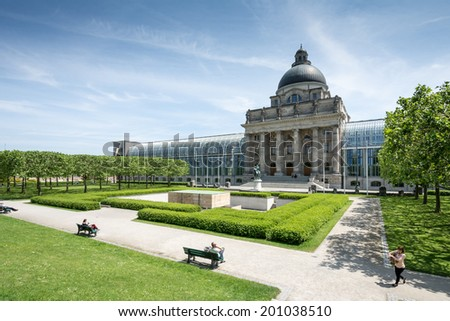 MUNICH, GERMANY - JUNE 4: Tourists at Hofgarten park in Munich, Germany on June 4, 2014. The public renaissance garden was created in the 17th century. View to the State Chancellery - stock photo