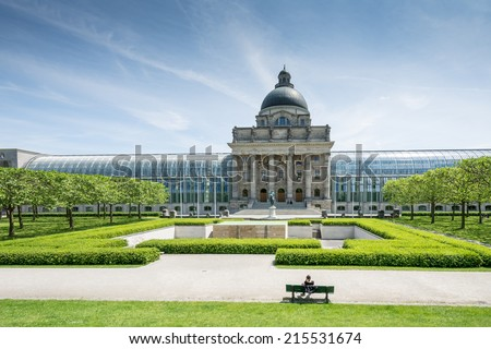 MUNICH, GERMANY - JUNE 4: Tourists at Hofgarten park in Munich, Germany on June 4, 2014. The public renaissance garden was created in the 17th century. - stock photo