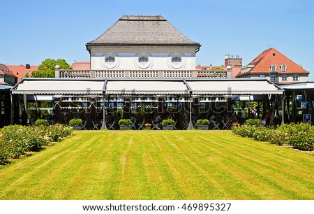 MUNICH, GERMANY - JUNE 23 ,2016 Visitors enjoy a pause and relax at the restaurant and beer garden of the Botanical Garden in Munich. The Garden created in 1914  cultivates about 14.000 species.