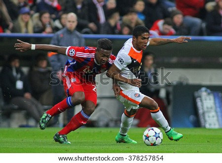 MUNICH, GERMANY - MARCH 11 2015: Bayern Munich's defender David Alaba  and Shaktar's midfielder Douglas Costa compete for the ball during the UEFA Champions League match - stock photo