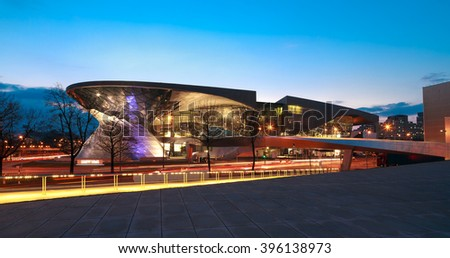 MUNICH, GERMANY - MARCH 8, 2016: BMW World (BMW Welt) in Munich at night, a multi-functional customer experience and exhibition facility of the BMW AG.