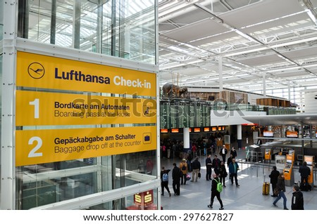 Munich, Germany - March 20, 2015: Lufthansa Check-in sign in Terminal 2 of Munich Airport. Lufthansa is the largest European airline and Munich's Terminal 2 is for Star Alliance use only.