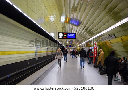 Munich,Germany-March 24,2016: People wait at a subway station in Munich,Germany for their train to arrive