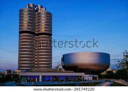 MUNICH, GERMANY - May 7,2015: BMW Headquarters during dusk  on May 7, 2015 in Munich.BMW Museum is located near the Olympiapark in Munich and was established in 1972 shortly before the Summer Olympics - stock photo