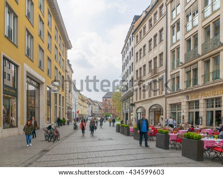 Munich, Germany - MAY 2016 : Tourists at shopping street nearby Marienplatz where is a central square in the city centre of Munich, Germany. It has been the city's main square since 1158.