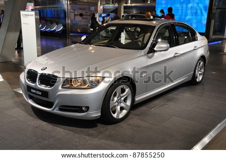 MUNICH, GERMANY - OCTOBER 31: BMW Motor Show on October 31, 2011 in BMW Welt in Munich, new BMW 3 Series - stock photo