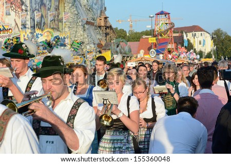 MUNICH, GERMANY - SEPT. 21, 2013: Traditional Marching Band entertains Crowds of visitors at the annual Oktoberfest..   The Festival runs from Sept. 21 - Oct. 6  in Munich, Germany - stock photo