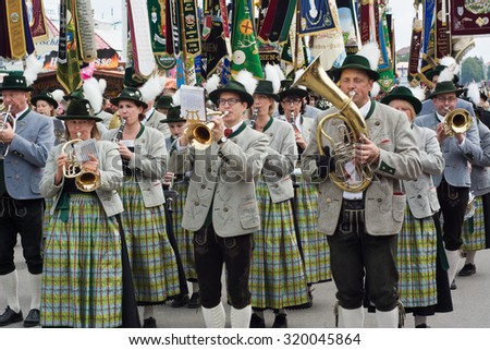 MUNICH, GERMANY - SEPT. 20, 2015: Traditional Marching Group with Costumes entertain Crowds of visitors at the Oktoberfest. The Festival runs from Sept. 19th until Oct. 4th 2015 in Munich, Germany.