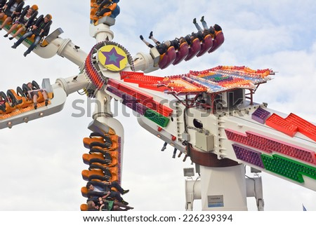 MUNICH, GERMANY - SEPT. 26, 2014: Visitors on an Amusement Park Ride  at the 181st Oktoberfest. The Festival runs from Sept. 20 - Oct. 5  in Munich, Germany - stock photo