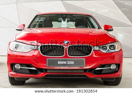 MUNICH, GERMANY - SEPTEMBER 19, 2012: New model BMW 328i against modern design surface. - stock photo