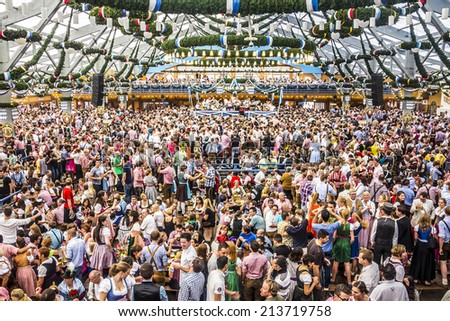MUNICH, GERMANY - SEPTEMBER 23, 2012: Oktoberfest, Munich: Overview over the big beer tent. In the background is the band. - stock photo